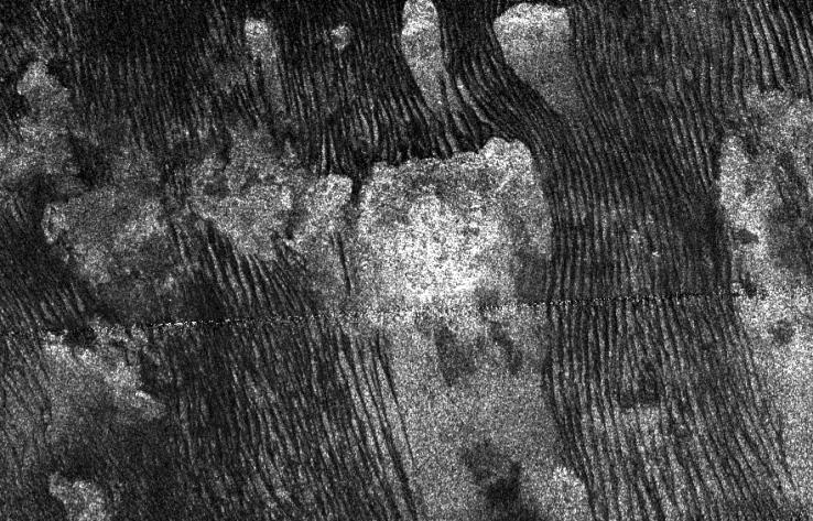 Titan's hydrocarbon dunes. Captured by Cassini.