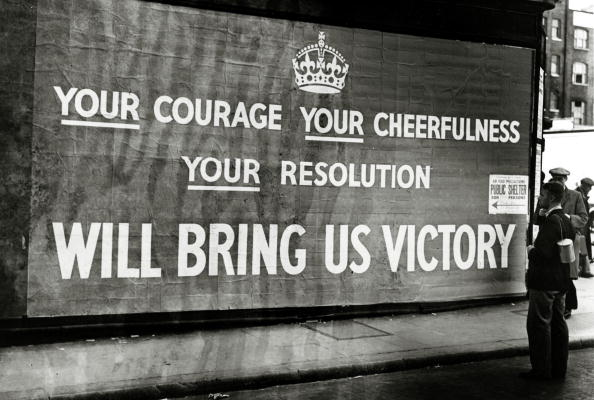 War and Conflict, World War Two, pic: September 1939, Great Britain, A poster on a London street giving encouragement towards final victory (Photo by Popperfoto/Getty Images)